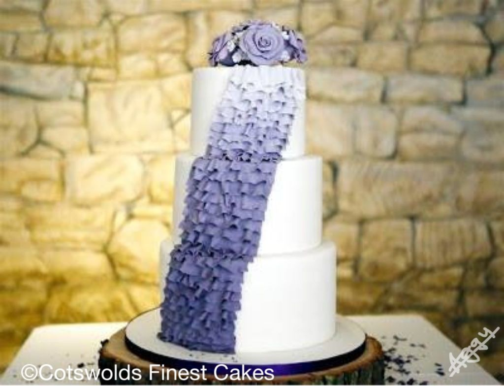Purple ombré ruffles on a white simple cake with purple sponge and ...