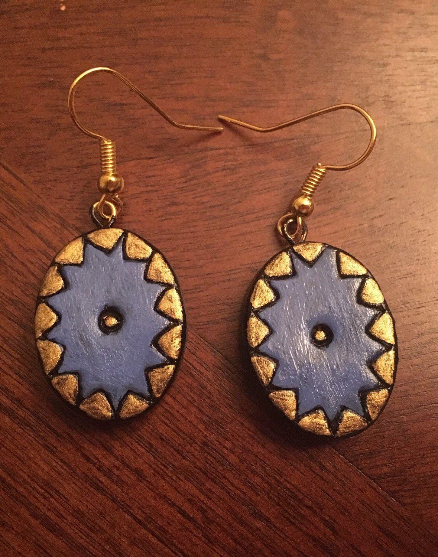 Handmade Blue Terracotta earrings by Riyaterracotta on Etsy https://www.etsy.com/listing/266935092/handmade-blue-terracotta-earrings