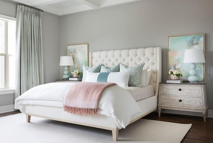 cream tufted bed with light blue triple