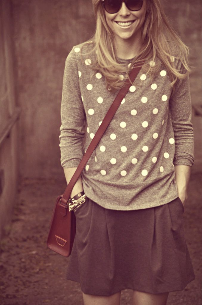 grey shirt over black skirt. with a cream scarf?