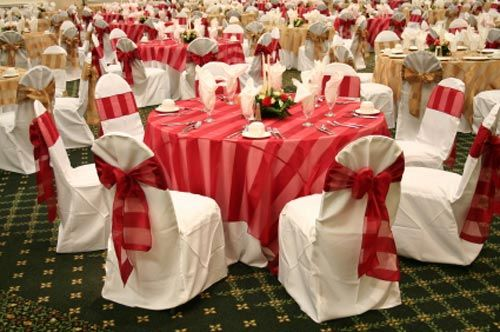 Loving the red stripes just enough to be different but not wedding chair decorations and chair covers create an elegant atmosphere and are one of the most perfect wedding decorating ideas wedding chair sashes and junglespirit