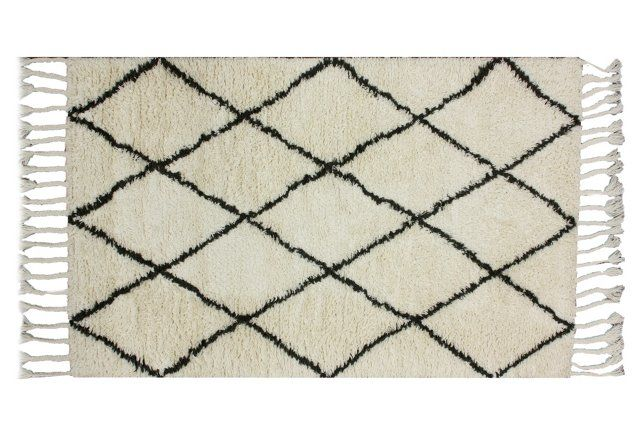 Add a modern dose of Moroccan flair to your living room with this chic black & white diamond rug!