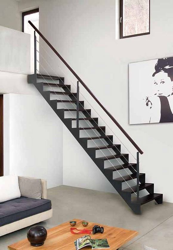 Metal stairs in a minmal home barandillas de interior - Barandilla escalera madera ...