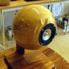An ikea wooden bowl lacquered to a glossy finish and used as an open baffle speaker enclosure