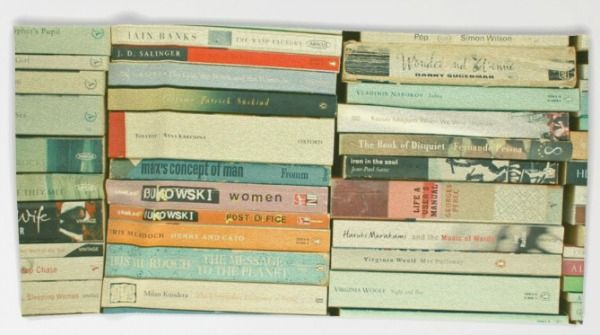 This bookish beach towel looks like a beautiful stack of well-loved books.