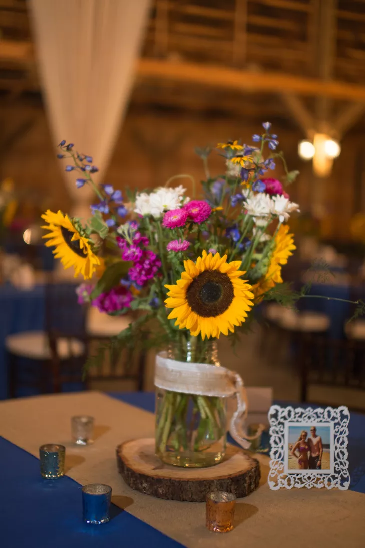 Sunflower and Wildflower Centerpiece on Wooden Slab