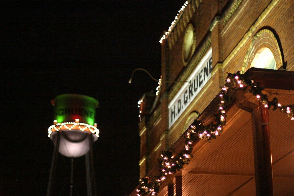 The iconic water tower in Gruene Texas gets a holiday makeover for the Christmas season. Read more at sandsunandmessybuns.com #gruenetexas #texastourism #smalltowndestinations