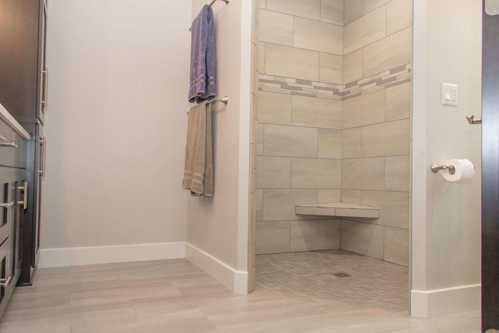 Beige Tile Bathroom Floor And Shower With Accent Strip Tile Bathroom Flooring Beige Tile Bathroom Shower Floor