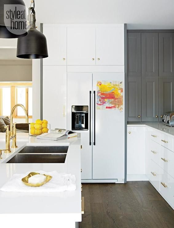 Contemporary two tone kitchen features glossy white Ikea cabinets ...