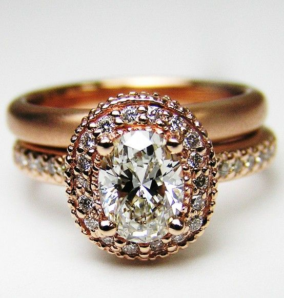 Rose gold with oval diamond