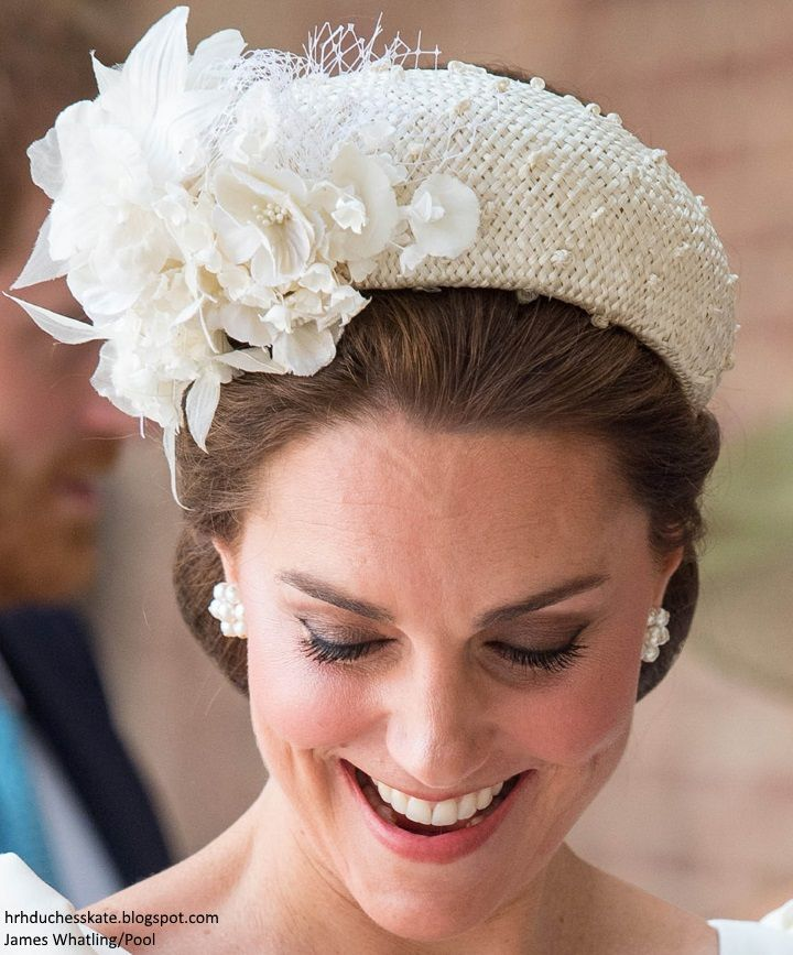 It was a hat trick for McQueen and Jane Taylor today with Kate selecting the designer and milliner once again. Kate's bespoke dress features a v neck and puff sleeves. It was a very elegant look and an ideal choice for the occasion. A closer look at Kate's Jane Taylor headband style hat with floral detail.