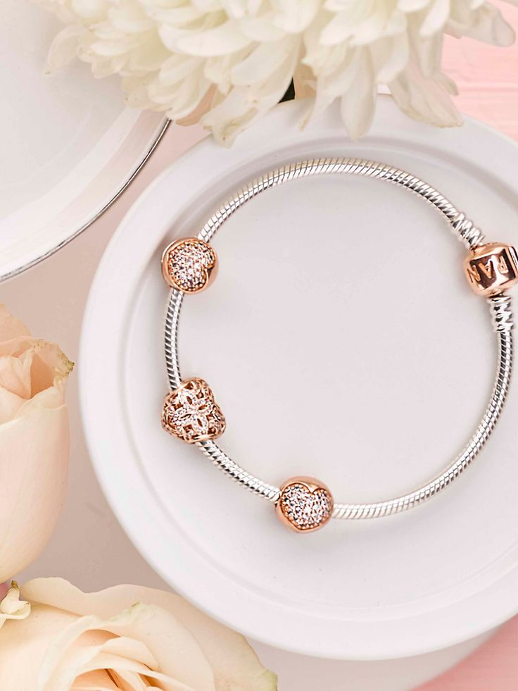 This season, the PANDORA Rose collection presents glittering and ...