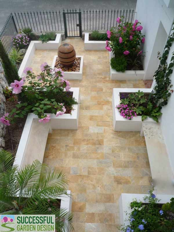 Spanish courtyard garden via successful garden design blog for Very small courtyard ideas