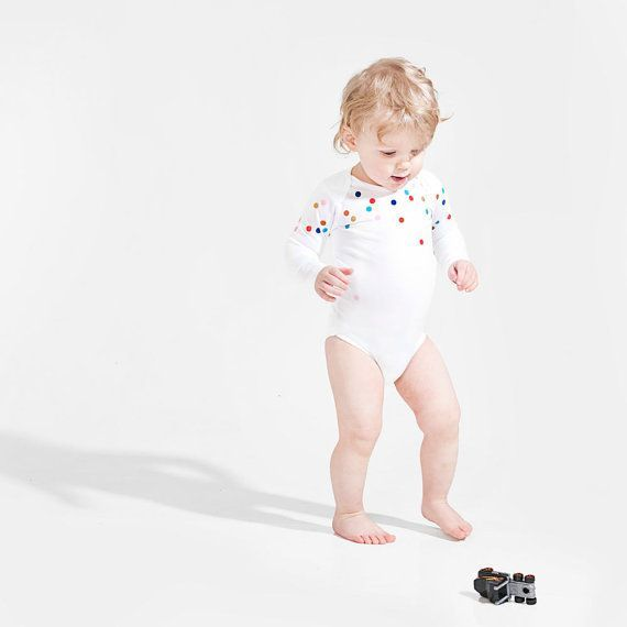 An adorable onesie with a sprinkling of colorful dots. #EtsyNetherlands
