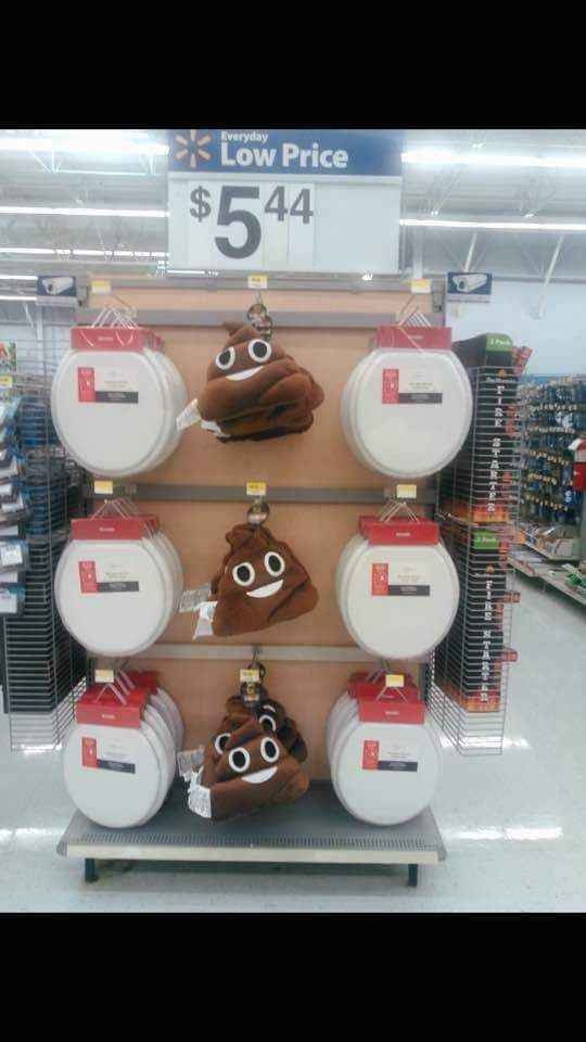 A Poop Emoji Pillow And Toilet Seat Display At Walmart Ift