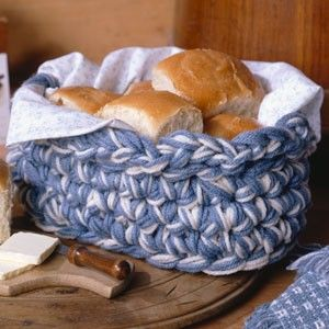 """Leisure Arts - Baker's Basket Crochet Pattern ePattern, $2.99 (http://www.leisurearts.com/products/bakers-basket-crochet-pattern-digital-download.html).  Size: 7""""w x 9""""l x 4""""h  Present baked goodies in this country keeper, and you'll truly be giving a gift with homemade flavor. The basket works up quickly using six strands of worsted weight yarn and a size Q (15 mm) hook."""