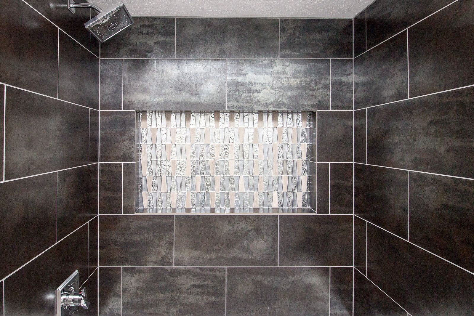 #MosaicMonday highlights a GORGEOUS installation by @Griffin Construction out of Houston, Texas, using our Alchemy Series in Silver and Imagine Mosaic! #mosaic #Monday #texas #southern #living #houston #tx #hou #alchemy #silver #imagine #motivationmonday #homedecor #interiordesign #design #home #DIY #bathroom #walltile #decor #decorative #glass #stone #metal #porcelain
