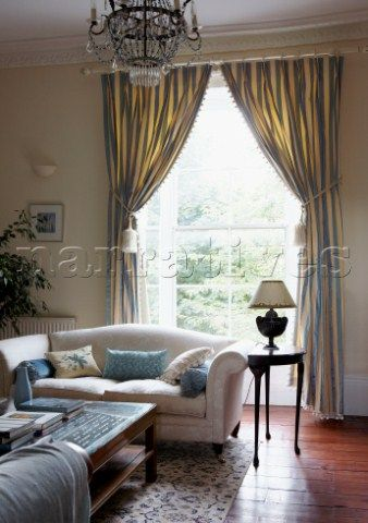 Striped Curtains At Window Of Georgian Townhouse Living Room
