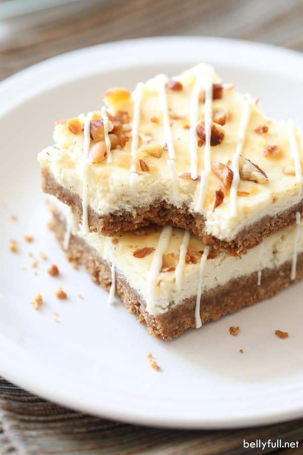 Eggnog Cheesecake Bars with White Chocolate Drizzle #eggnogcheesecake These Eggnog Cheesecake Bars are luscious cheesecake in bar form, with an eggnog flair, and drizzled with melted white chocolate! #cheesecakebars #cheesecakebarsrecipes #eggnogcheesecake #eggnogcheesecake