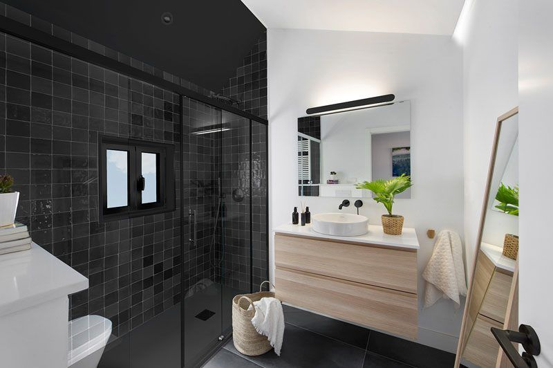 Black And Green Accents Are Used Throughout This Spanish Apartment Spanish Apartment Bathroom Lighting Design Apartment