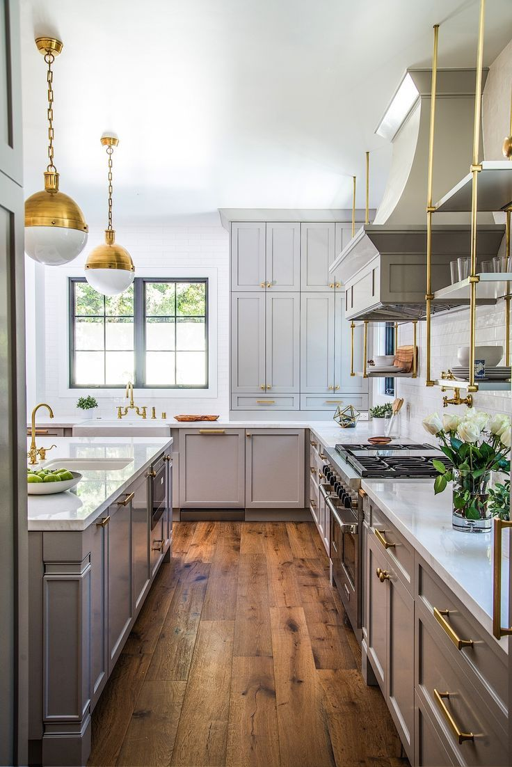 brass accents & grey cabinets | modern cape cod kitchen at bundy in