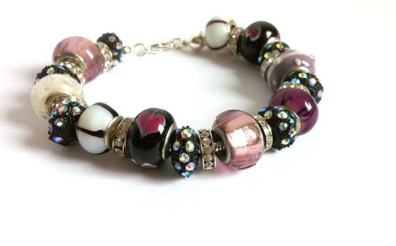 European Style Large Hole Beads Bracelet by ClearWaterDesignsbyK Https://clearwaterdesignsbyk.etsy.com Https://clearwaterdesigns.info This Purple Pink & Black European Style Bracelet is the perfect Xmas gift under $35.00! This European Style Bracelet is is packed full with gorgeous High End European Lampwork & Silver Foil Beads in Pink, Purple, White & Black.