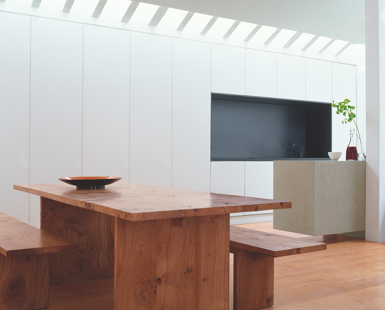 Mayfair Mews House, London. Dining room towards the kitchen. Gavin Jackson Architects.
