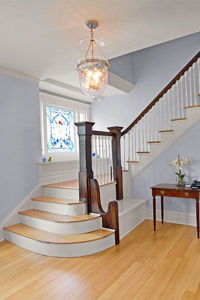 The Blond Vertical Bamboo In This Formal Entry Creates A Serene Backdrop For Pale Blue Walls Crisp White Trim And Dark Stair Parts