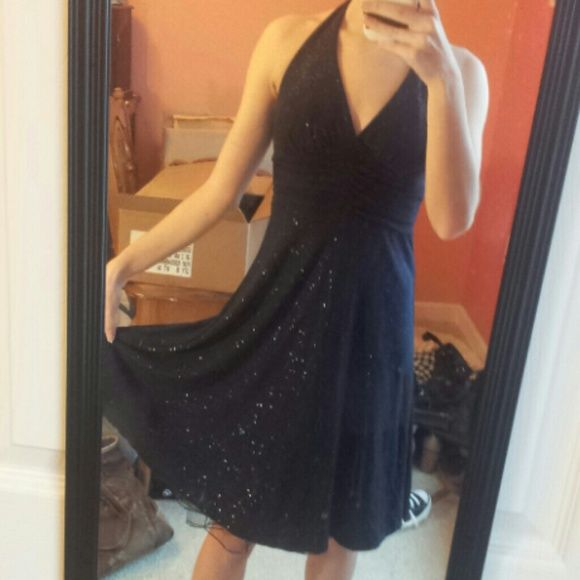 Sparkly midnight blue formal dress Dark blue halter dress with sparkles. Black fabric under bust and black netting underneath skirt. Pretty ball gown, great for prom. The tag says 7/8, but it fits me and I'm a 2. B. Darlin Dresses