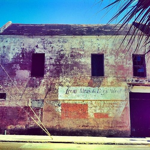 jasonsapia:   one of charleston's old buildings…   Old Leon's Men's & Boy's Wear signAt the intersection of King and M...