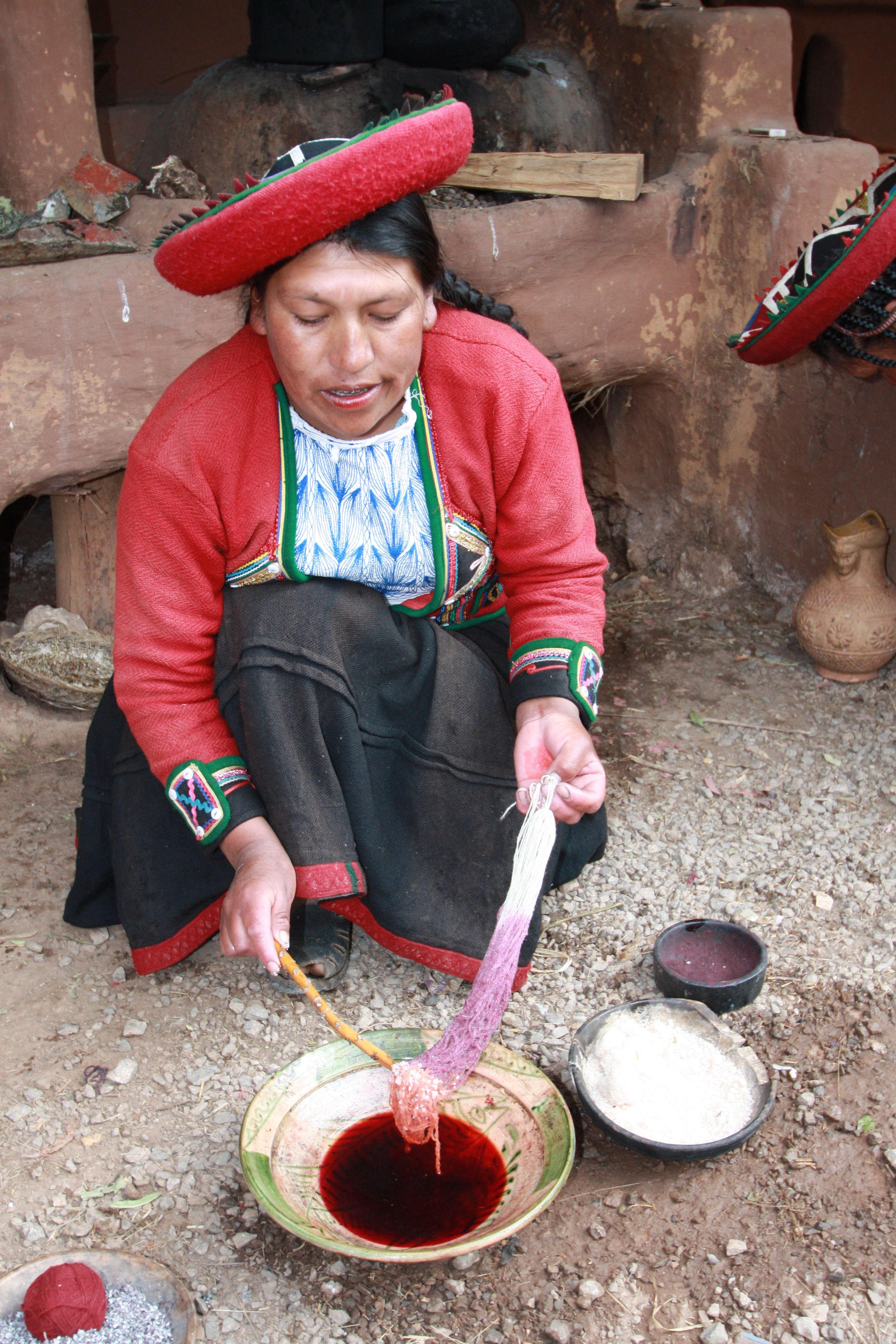 Hand dying of Alpaca fibers in Chinchero, Peru. These fibers will be dried and then woven into textiles on wooden looms in the same manner the Incas did for generations.
