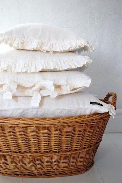 Ruffled pillows, wicker basket