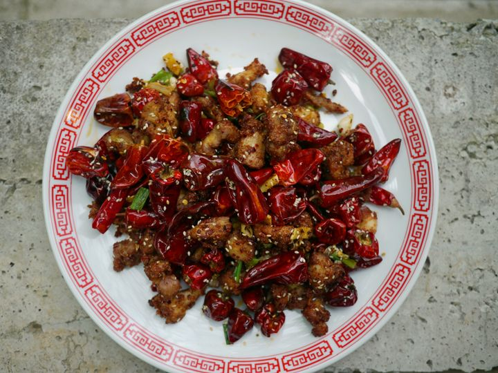 A recipe for Chongqing chicken—sometimes called la zi ji—fried chicken sitting under an avalanche of dried chili peppers.