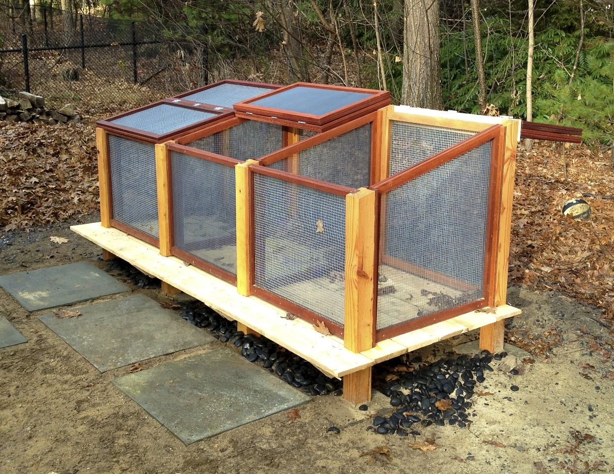 Compost bin with removable mesh screens in front, slightly raised ...