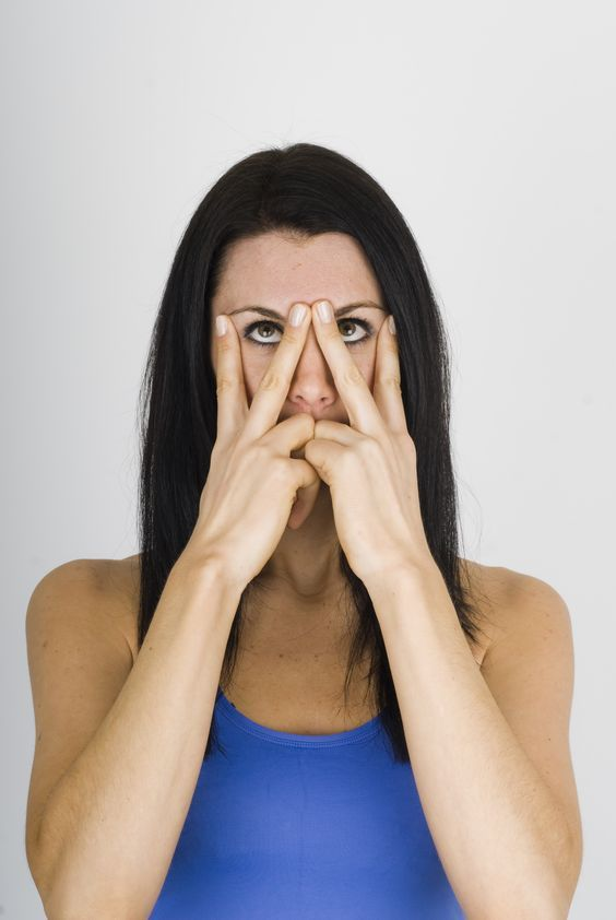 In order to keep lines and wrinkles away from eye and prevent dark circles, practice this exercise , Put both your middle fingers together between your eyebrows, then apply pressure to the outer corners of your eyes with your index fingers. Look up and start to move the lower eyelid upwards, making a strong squint. Then relax and repeat six more times.