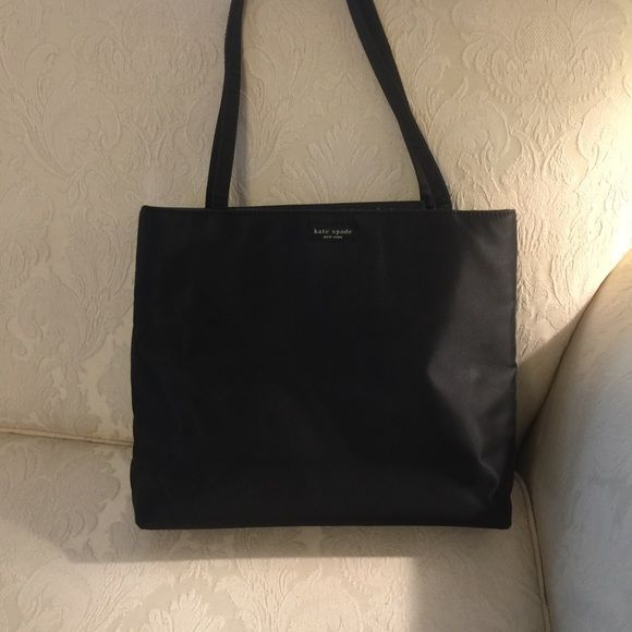 "Vintage Kate Spade Handbag. Circa 2000 Original black  nylon tote/shoulder 10"" drop, approx 13"" x 11"" and 4"" depth, one zippered pocket inside with snap close top. This bag has been loved but not used in a long time. Bag is clean however worn slightly on edges, as would be expected. kate spade Bags Shoulder Bags"