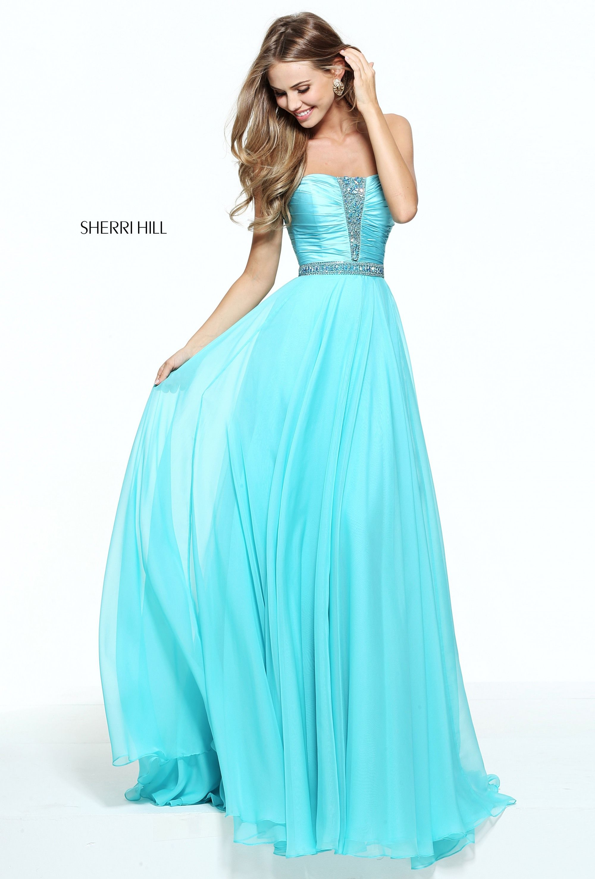 Tonal beadwork accents the ruched bodice of this sherri hill