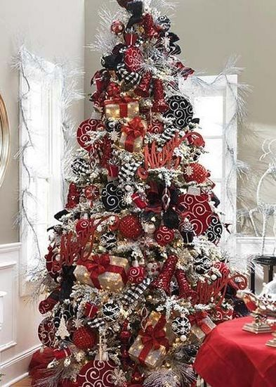 thinking black and white damask ribbon this year with red accents i like the small wrapped packages on this tree as ornaments too