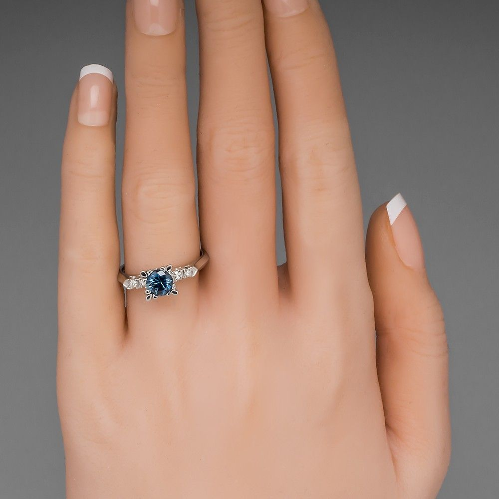 This crisp greenish blue Montana sapphire stone has a great cut and is set in a beautiful 1950's platinum mounting.  This ring is perfect for the finance to be that wants to see some color every day.  Nice single cut diamonds are set to each side of the sapphire and this ring can be sized prior to shipping so it arrives ready to present.