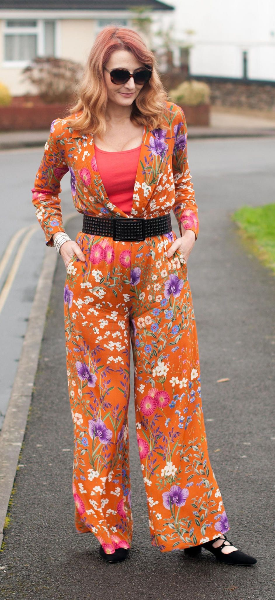 bc7ae319ac Wearing Florals in Winter  Wide leg orange floral jumpsuit from Mango with  black accessories