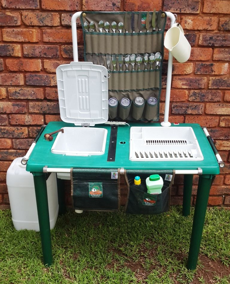 Made this DIY Camping dishwashing station from a plastic patio table,  Everything folds away and