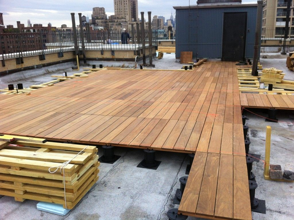 A Pedestal Decking System Being Installed On A Rooftop In