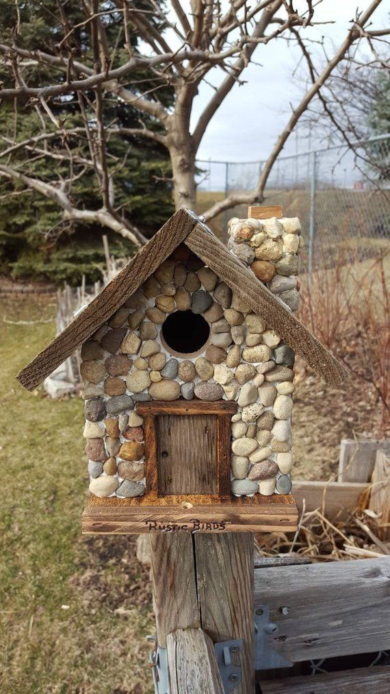 Birdhouse with stones covering front side and chimney #birdhouses
