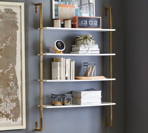 With Just The Right Touch Of Shine This Large Scale Storage Piece Is A Polished Base To Show Off Your Favorite Wall Mounted Shelves Shelves Nursery Wall Shelf