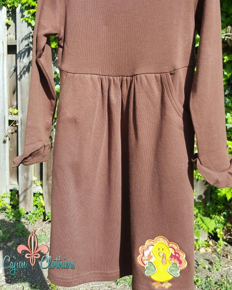 Brown dress featuring turkey applique from Cajun Clothiers