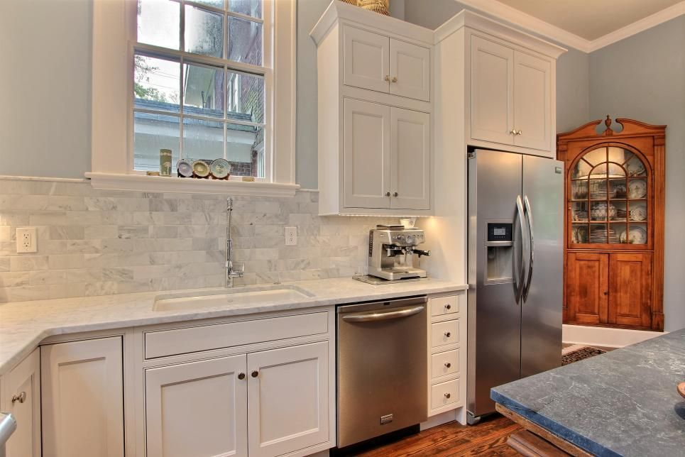 A built-in breakfront cabinet and original refinished ...