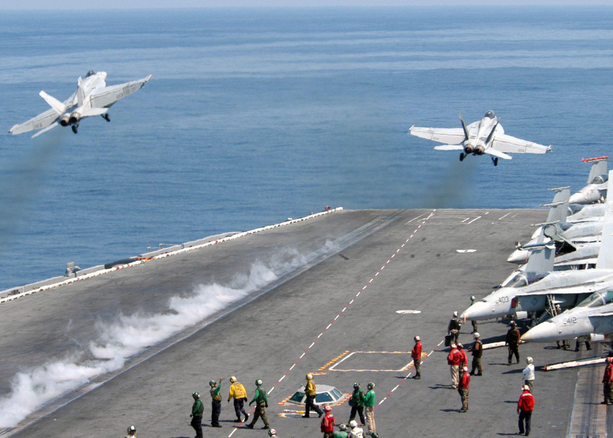 """ATLANTIC OCEAN (August 2, 2007) - An F/A-18E Super Hornet assigned to the """"Pukin Dogs"""" of Strike Fighter Squadron (VFA) 143 and a F/A-18C Hornet assigned to the """"Wildcats"""" of Strike Fighter Squadron (VFA) 131 launch off the flight deck of the Nimitz-class aircraft carrier USS Dwight D. Eisenhower (CVN 69) during flight operations."""
