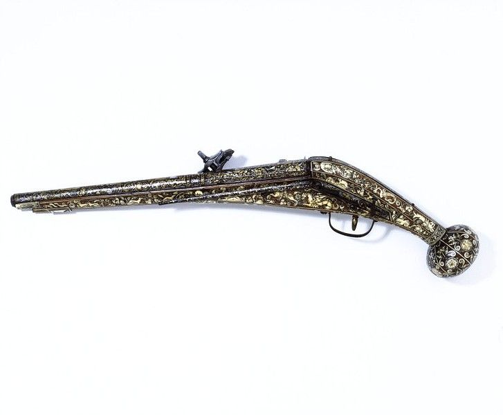 Wheel lock pistol, ca. 1580.  Steel barrel, wooden stock inlaid with engraved staghorn; barrel mounts damascened in gold and silver.