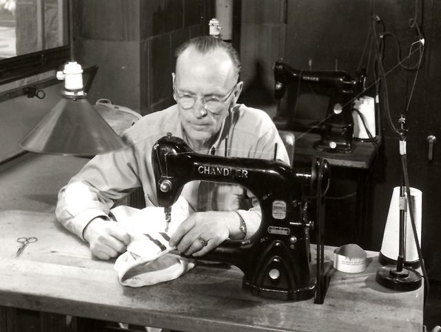Football Equipment Manager Eugene Roberts Stitching 1950 Image S06168 For More Information About This Football Equipment Uw Madison Football Training