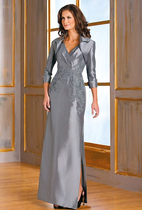 Mother of the Bride/ Groom. Jade by Jasmine. Project distinguished sophistication with this beautiful special occasion gown. A classic silhouette of a V-neckline and sheath skirt come together in this luminous taffeta dress. This dress is touched up with the detailed lace detail on the bodice.